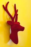 Decorative Christmas reindeer red velvet on yellow background. Decorative Christmas happy reindeer red velvet on yellow background Royalty Free Stock Photos