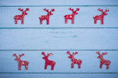 Decorative Christmas reindeer on wooden background§ Stock Photo