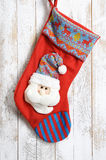 Decorative christmas sock with santa. Isolated on wooden backgro Stock Photography