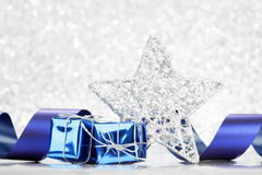 Decorative christmas star and gifts Stock Photography