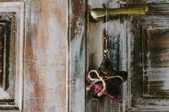 Decorative christmas star hanging on the old door handle Stock Photos