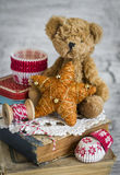 Decorative Christmas star, old books, paper molds for baking, toy bear Stock Photos