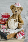 Decorative Christmas star, old books, paper molds for baking, toy bear Stock Photo