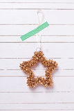Decorative Christmas star  on  wooden background. Royalty Free Stock Photography