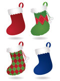 Decorative Christmas Stockings. Four festive Christmas stockings: two traditional style stockings and two fuzzy, patterned stockings. Drop shadows on separate Royalty Free Stock Photography