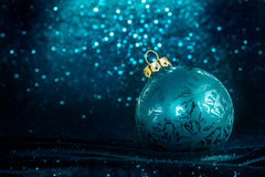 Decorative Christmas tree ball in front of sparkling background. With ice crystals frame Stock Image