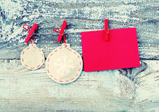 Decorative Christmas tree decorations from paper and empty red card on a rope against the background of the old removed board Royalty Free Stock Photography