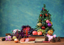 Decorative Christmas tree and food Royalty Free Stock Photography
