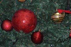 Decorative christmas tree for holidays Christmas and New Year`s. Christmas tree decorated with balls of various design and shapes and decorative elements Royalty Free Stock Photos