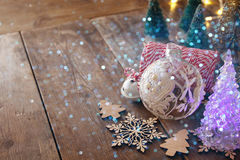 Decorative christmas tree next to decorations Royalty Free Stock Image