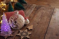 Decorative christmas tree next to decorations Royalty Free Stock Photo