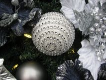 Decorative Christmas tree with a sparkling ball Stock Photo
