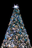 Decorative Christmas tree with toys on a black Royalty Free Stock Photo