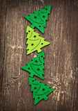 Decorative Christmas Trees on Wooden Background Royalty Free Stock Photos