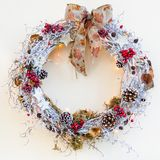 Decorative Christmas wreath picture on neutral background. Decorative Christmas wreath, front view picture of decoration on neutral background royalty free stock image