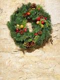 Decorative Christmas wreath on vintage stone wall Stock Photos