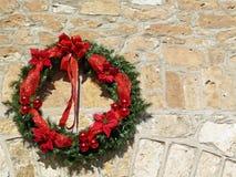 Decorative Christmas wreath on vintage stone wall Royalty Free Stock Photos