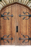 Decorative church door with iron hinges. Decorative church doors with iron hinges Stock Photos