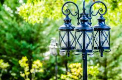Decorative classic lamp post in garden Royalty Free Stock Images