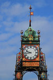 Decorative clock tower against a blue sky royalty free stock image
