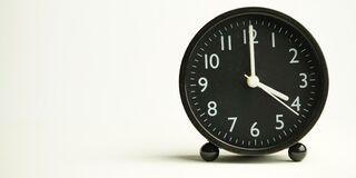 Free Decorative Close-up Black Analog Alarm Clock For 4 Or 16 O`clock, Separate White Background With Copy Space Royalty Free Stock Images - 197030689