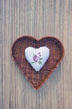 Decorative cloth heart in wicker basket Royalty Free Stock Image