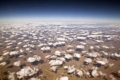 Decorative Clouds at 30,000 feet. Decorative Clouds over the arid deserts of New Mexico Stock Photo