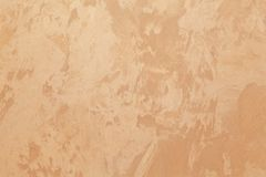 Decorative coating for walls - beige, orange silk, handmade Royalty Free Stock Photo