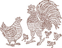 The decorative cock, hen and chickens Royalty Free Stock Photography