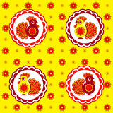 Decorative cockerels. Seamless pattern with decorative cockerels in folk style Royalty Free Stock Photos