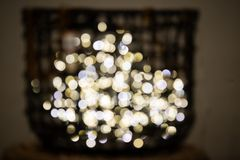 Decorative colored fairy lights blurred with larger bokeh, on display in a basket. Decorative colored fairy lights blurred with larger bokeh - on display in a royalty free stock photography
