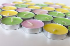 Decorative Colored Tea Candles of pink, yellow and green colors. Decorative Colored Tea Candles of pink, yellow and green colors Stock Photos