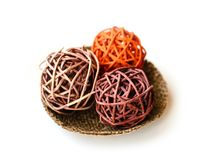 Decorative colored wicker balls on a plate from canvas white bac. Kground. Decor photo Royalty Free Stock Photography