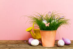 Decorative Colorful Eggs in Flower Pot with Fresh Green Grass on Royalty Free Stock Photos