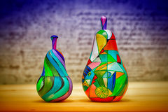 Decorative colorful fruit pear made of wood, hand-painted Stock Photos