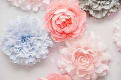 Decorative colorful paper flowers at the wedding ceremony. Blur style photo of the paper beautiful roses background for decorate the wedding ceremony Stock Photo