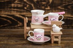 Decorative Colorful Porcelain Coffee set on Wooden Background Royalty Free Stock Images