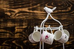 Decorative Colorful Porcelain Coffee set on Wooden Background Stock Photo