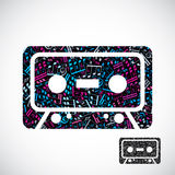 Decorative colorful vector cassette tape symbol filled with musi. Cal notes  on white background Royalty Free Stock Photo