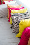 Decorative comfortable pillow natural Fabric, with multi-colored pillows Stock Photos