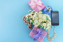 Decorative composition boxes with gifts flowers women& x27;s jewelry shopping holiday blue background. Festive poster copy space stock photos