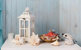 Lantern and seashells. Decorative composition in marine style with lantern and seashells royalty free stock photo