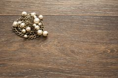 Decorative composition of women`s jewelry on wooden dark background. Flat lay. The view from the top. The concept of fashion and beauty royalty free stock images