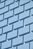 Decorative concrete wall with a relief similar to a large brick masonry painted in bright blue paint.  royalty free stock photo