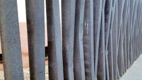 Decorative concrete wall sculpture with vertical struts. Stock Image
