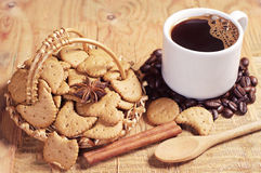 Decorative cookies in wicker basket and coffee Stock Image