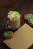 Decorative cookies on wooden background. Saint Patricks Day concept Royalty Free Stock Photo