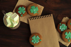 Decorative cookies on wooden background. Saint Patricks Day concept Stock Photos
