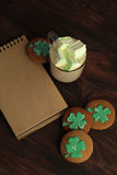 Decorative cookies on wooden background. Saint Patricks Day concept Stock Photo