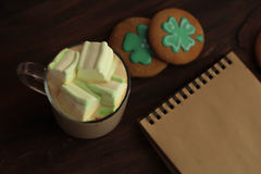 Decorative cookies on wooden background. Saint Patricks Day concept Stock Image